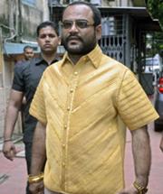 Pankaj Parakh, an Indian businessman, wearing his gold shirt, valued at $210,600.