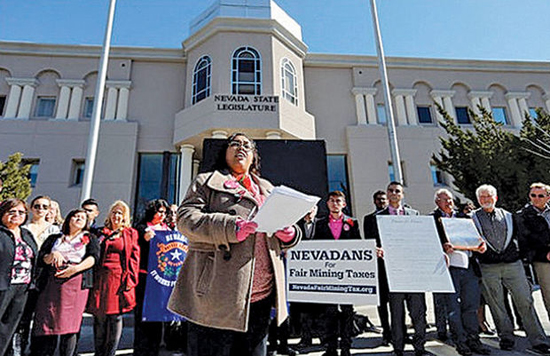 Laura Martin, a spokesperson for the Progressive Leadership Alliance of Nevada, speaks at a rally for fair mining taxes in front of the Legislative Building on Feb. 14, 2013, in Carson City, Nev. (AP Photo/Cathleen Allison)